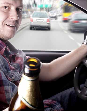 man drinking whilst driving