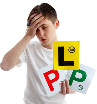 learner driver holding L and P plates