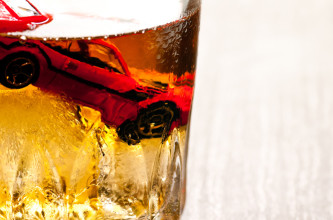 car in glass of alcohol
